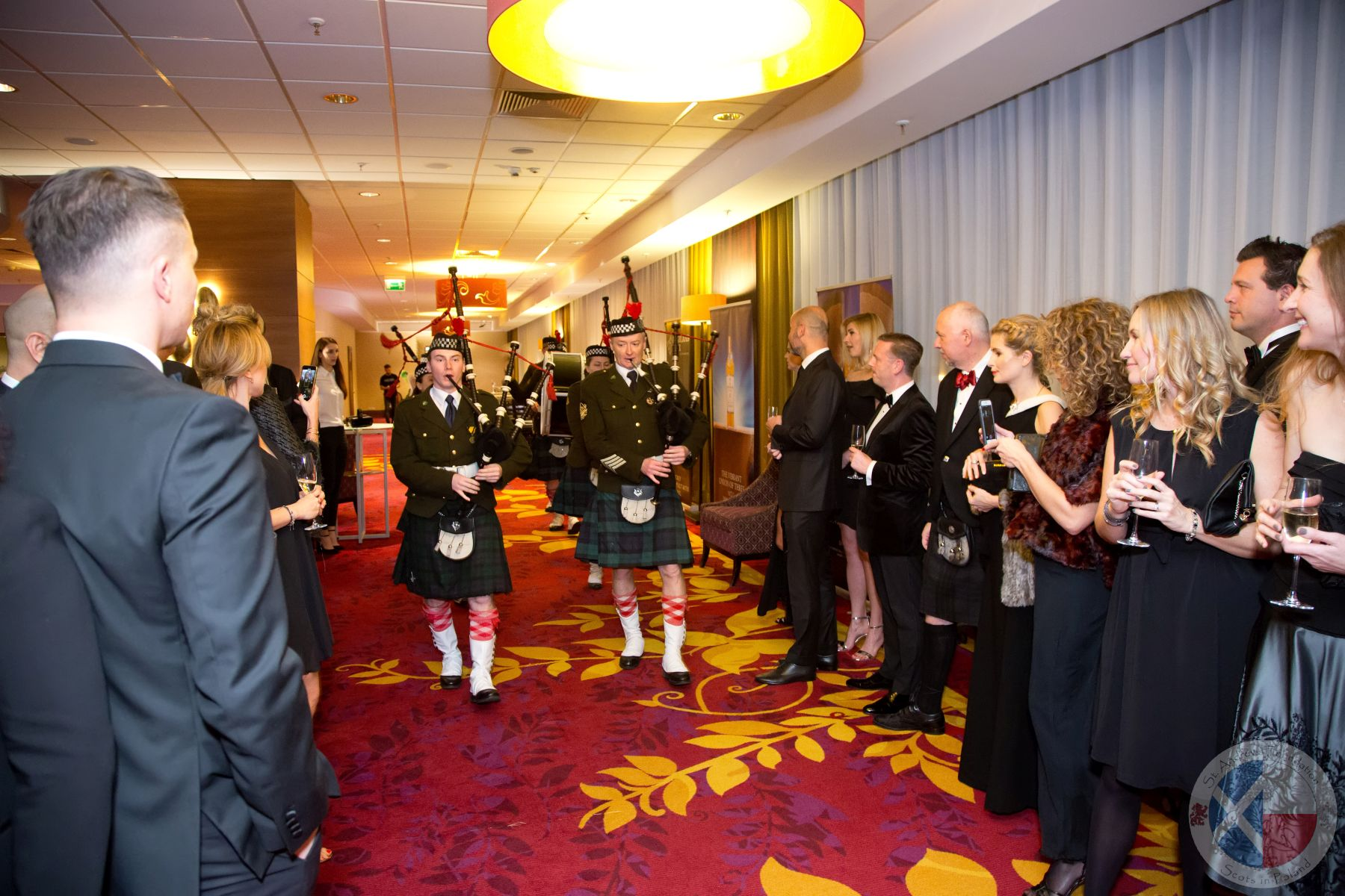 The Pipe Band leads the company to dinner