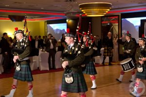 The Pipes and Drums entertain the company during dinner