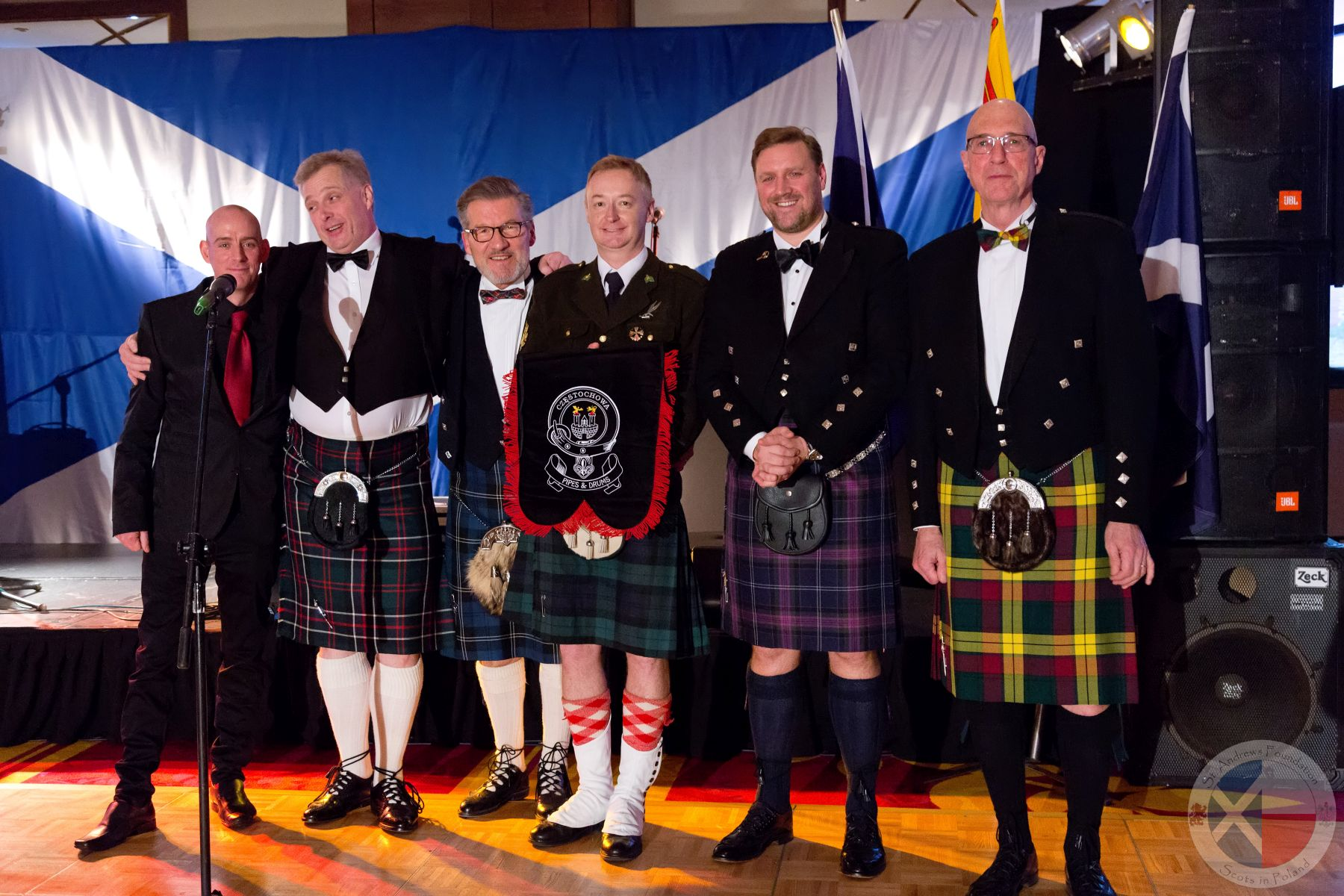 Pipe Major Tomasz Ujma (centre) with his new bagpipe pennant.